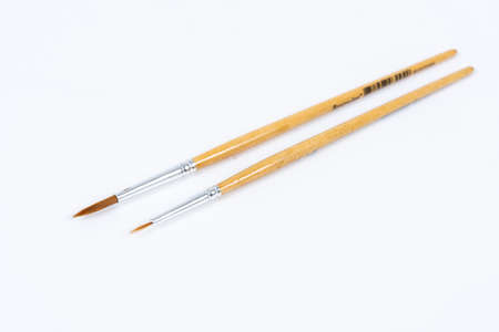 Painting brushes. Drawing tools, paint brushes on white background, copy space, top view