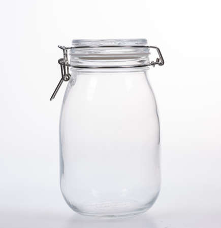 Glass jar with lid on white background Stock Photo