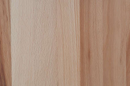 Background, wood structure of a cherry wood panel. photo