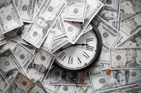 Abstract background of U.S. dollar and a clock. photo