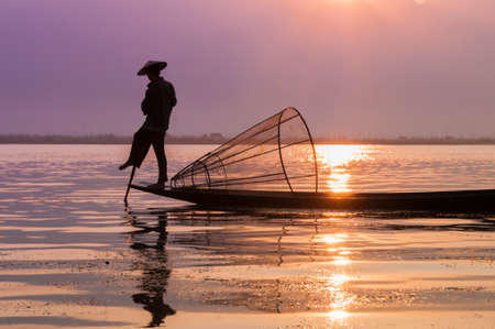 Fishermen on Inle Lake at sunrise, Burma, Myanmar. photo