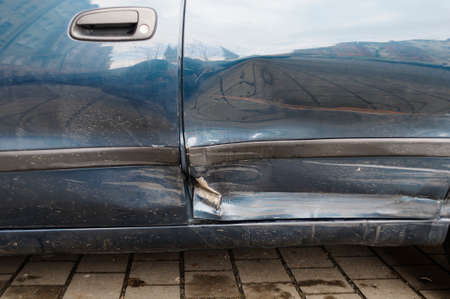 carelessness: Accident damage on the left side by the car. Stock Photo