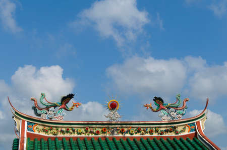 rooftop: Ornamentation from a rooftop on a chinese temple in Malaysia. Stock Photo
