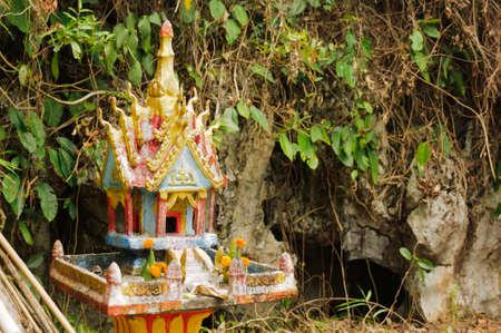 lao: Buddhist  family altar in Lao, Asia. Stock Photo