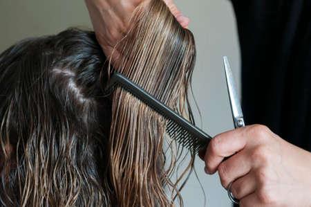 gets: Woman gets their hair cut.