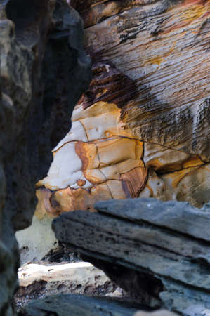 structuring: Natural colors yellowish,reddish eroded sandstone. Stock Photo