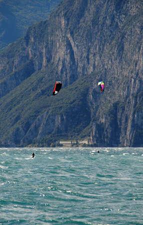 kiteboarding: Water sports, kite-boarding on the lake garda north Italy.