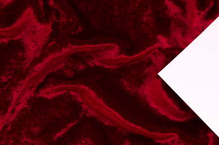 red velvet: Red velvet as abstract background with white triangle for copy space. Stock Photo