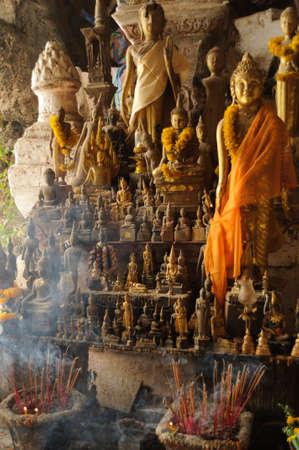 ou: Buddha figure in the Pak Ou cave`s near Luang Prabang.