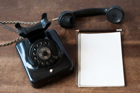 composition notebook: Old phone with writing pad for Copy Space and pencil on a desk.