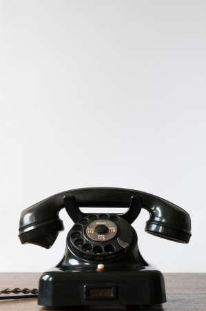 Old phone on a desk and white background for copy space. photo