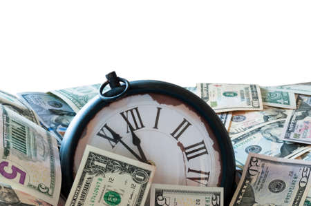 us dollars: US dollars and a clock is eleven fifty-five clock. Stock Photo