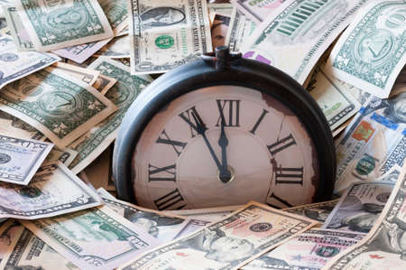 minute hand: Abstract background of U.S. dollar and a clock.