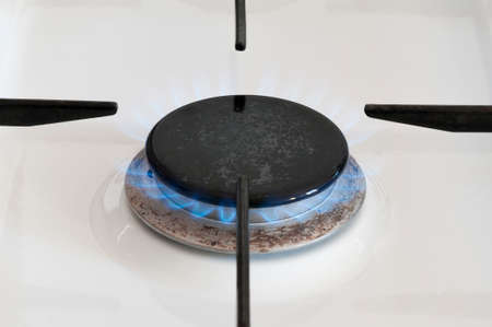 gas stove: Gas flame of a gas stove with Copy Space. Stock Photo