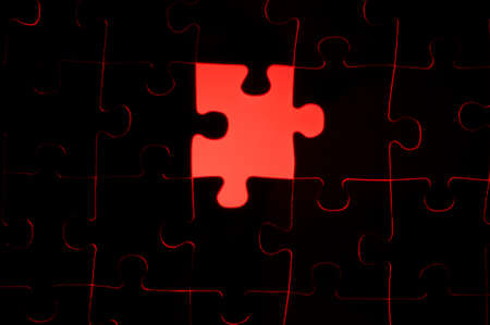 puzzle background: Symbol of solutions of business concepts, missing puzzle piece with a red glowing background.