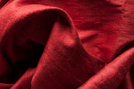 textured effect: Background of red raw silk with textured effect. Stock Photo