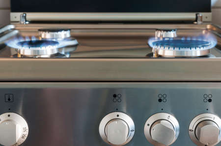 gas flame: Gas flame of a gas stove in stainless steel. Stock Photo