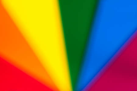 descriptive color: Blurred abstract background of rainbow colors.
