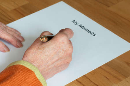 memoirs: Senior writes her memoirs on a white sheet of paper with heading.