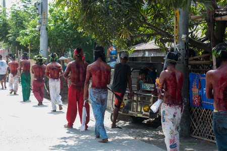 atonement: San Fernando , Luzon, Philippines, March 25, 2016 Easter procession in the city of San Fernando, Luzon Island, Philippines. Flagellants who mortify themselves on Good Friday on the road.