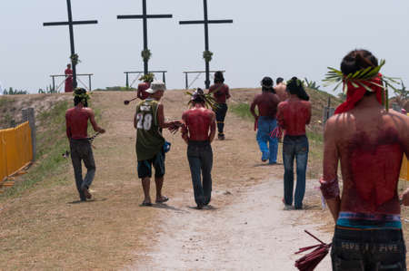San Fernando , Luzon, Philippines, March 25, 2016: Easter procession in the city of San Fernando, Luzon Island, Philippines. Flagellants who mortify themselves on Good Friday on a field.