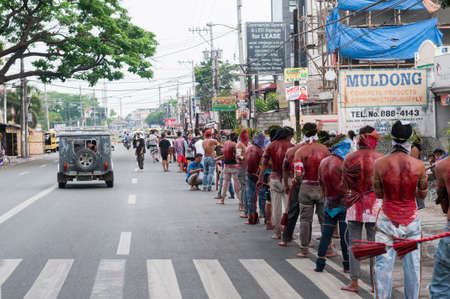 San Fernando , Luzon, Philippines, March 25, 2016 Easter procession in the city of San Fernando, Luzon Island, Philippines. Flagellants who mortify themselves on Good Friday on the road.