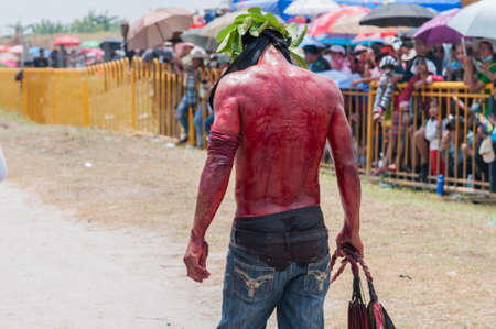 flagellation: San Fernando , Luzon, Philippines, March 25, 2016 Easter procession in the city of San Fernando, Luzon Island, Philippines. Flagellants who mortify themselves on Good Friday on the road.