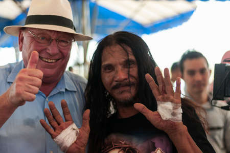 San Fernando , Luzon, Philippines, March 25, 2016: Robert Hetkaemper German journalist, East Asia correspondent in retirement and Ruben Enaje after his crucifixion on Good Friday. Editorial