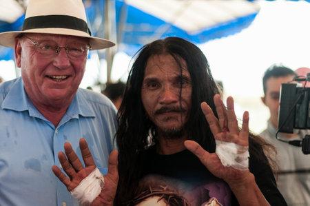 ard: San Fernando , Luzon, Philippines, March 25, 2016: Robert Hetkaemper German journalist, East Asia correspondent in retirement and Ruben Enaje after his crucifixion on Good Friday. Editorial