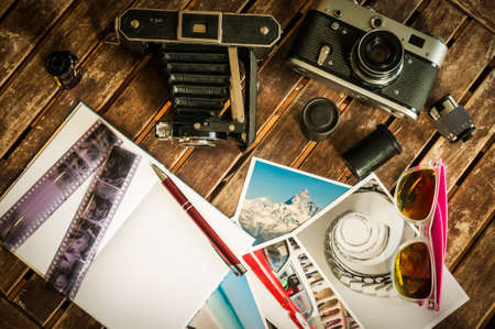 old photograph: Old retro cameras on a table with photographs, negatives and films with Copy Space.