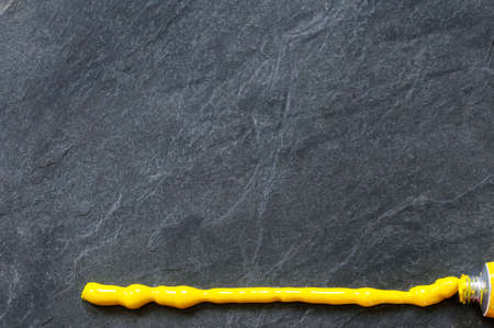 Background, black slate stone with texture and yellow line.
