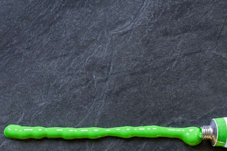 Background, black slate stone with texture and green line.
