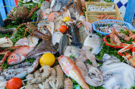Market stall with fresh fish and seafood.