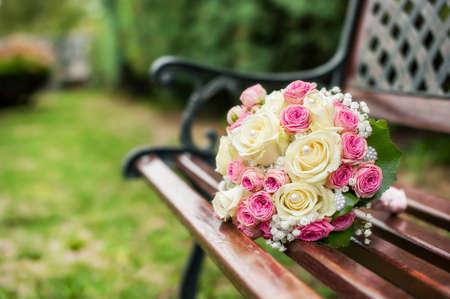 wedding buquet on a wooden bench
