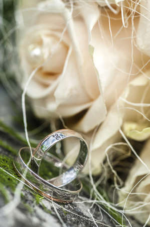 Two wedding rings on flowers background Stock Photo