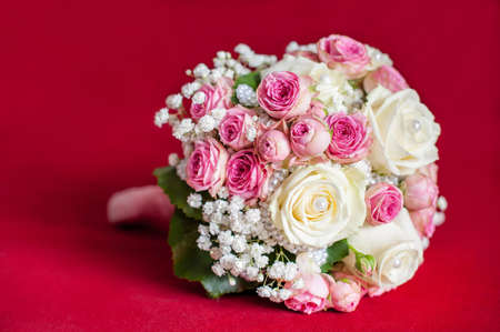 wedding bouquet on red background