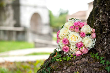 Wedding bouquet on tree and castle background