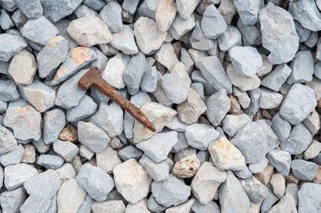 Iron wedge on stone background