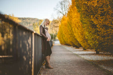Pregnant young woman relaxing outdoors