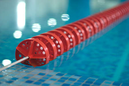 lane lines: swimming pool with red line diagonal Stock Photo