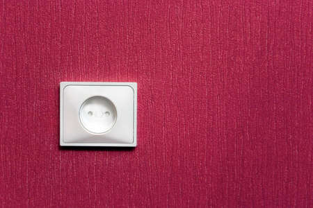 electric socket in the red wall photo