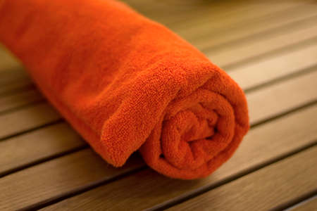 towel braided ore curtailed in a tubule on the wood chair