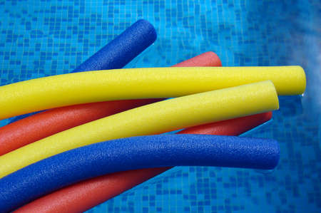 aqua noodles on the coast of swimming pool