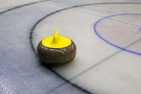 Granite stone for curling game on the ice 스톡 콘텐츠