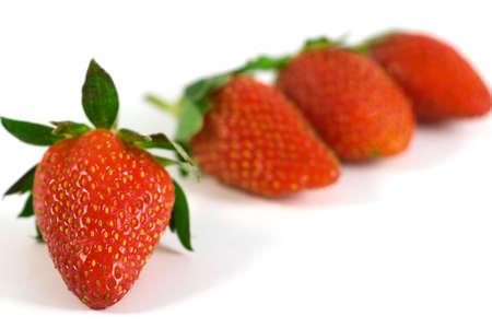 Four berries of wild strawberry on white background Stock Photo - 2869660