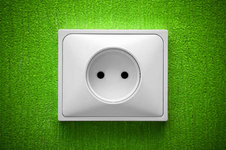 The socket in a green wall,vignette light photo