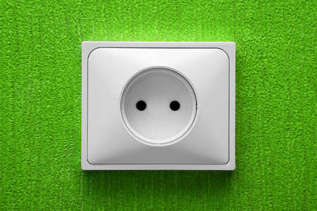 The socket in a green wall photo