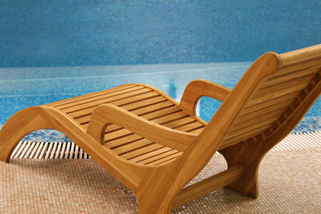 elbow chair: single sunbeds near the swimming pool