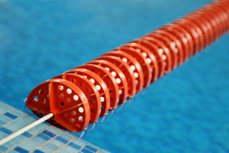 red Swimming Lane Marker in swimming pool photo