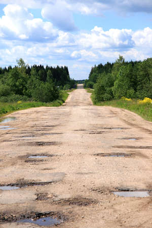 Road to wood with potholes